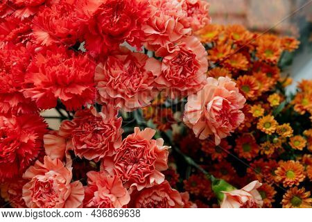 Bunches of orange flowers in a flower shop