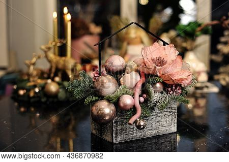 Merry Christmas Composition. Floral Bouquet With Christmas Balls, Fir-tree Branches, Festive Candles