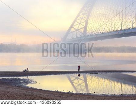 Novosibirsk Region, Siberia, Russia - 08.30.2020: Fisherman Have Bugrinskij Bridge In The Morning Mi