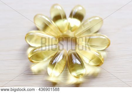 Transparent Capsule Supplements Arranged In The Shape Of A Flower