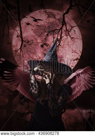 Halloween Witch With Wings Standing Over Zombie Hand, Cross, Church, Crow, Birds, Dead Tree, Full Mo