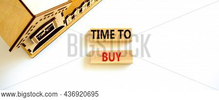 Time To Buy House Symbol. Concept Words 'time To Buy' On Wooden Blocks Near Miniature House. Beautif