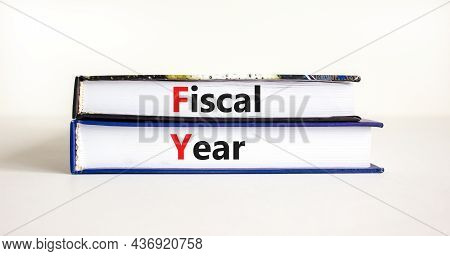 Fiscal Year Symbol. Concept Words 'fiscal Year' On Books On A Beautiful White Table, White Backgroun