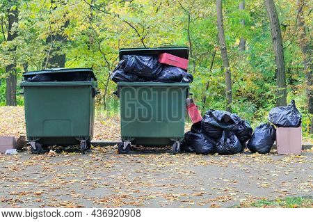 Dumpsters Being Full With Garbage In The Park. Garbage Waste Lots Junk Dump. Pin Ollution From Waste