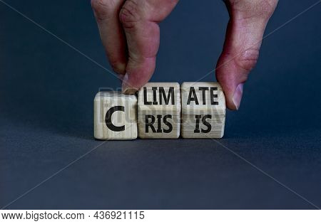 Climate Crisis And Change Symbol. Businessman Turns Wooden Cubes With Words 'climate Crisis'. Beauti