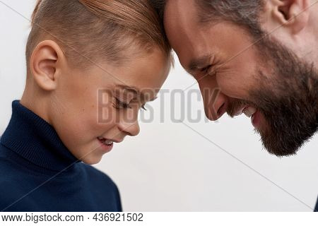 Close Up Of Loving Young Father And Small Teen Son Touch Foreheads Show Care Support In Family Relat