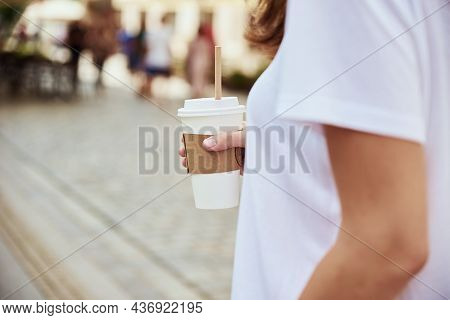 Coffee Paper Cup In Woman Hands. Woman Drinks Coffee To Go At City Street.