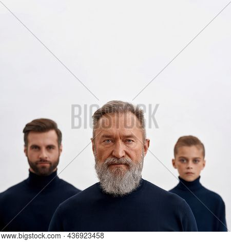 Narrow Shot Portrait Of Mature Caucasian Man Grandfather Forefront, Offspring Stand Back. Old Senior