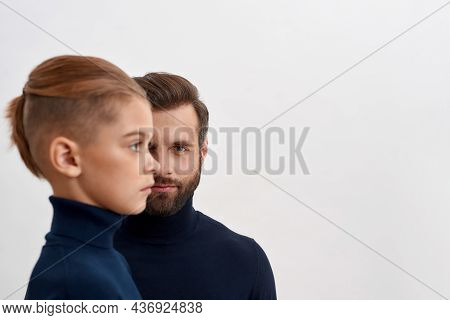 Portrait Of Caucasian Father Look At Camera Isolated On White Studio Background, Small Son Side Face