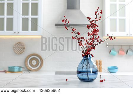 Hawthorn Branches With Red Berries On Table In Kitchen, Space For Text