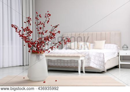 Hawthorn Branches With Red Berries On Wooden Table In Bedroom, Space For Text