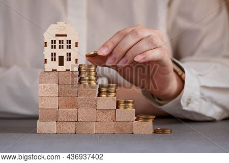 Coins On The Steps With A House At The Top, Hand Puts A Coin, New Home, Plan To Buy A House,  Proper
