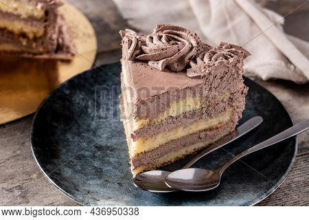 Piece Of Chocolate Truffle Cake On Rustic Wooden Table