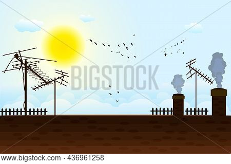 House Roof With Antennas On Sunny Sky Background. Roof Of The Building With Tv Antennas, Chimneys, S