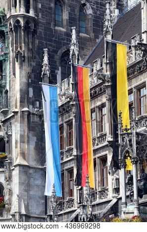 Three Large Flags On The City Hall Of Munich Symbolizing The Colors Of The City Of The Region Of Bav
