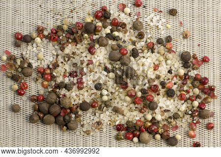 Spices, White, Black And Red Peppers, Sea Salt Sprinkled On A Grey Background, Close-up Top View Nar