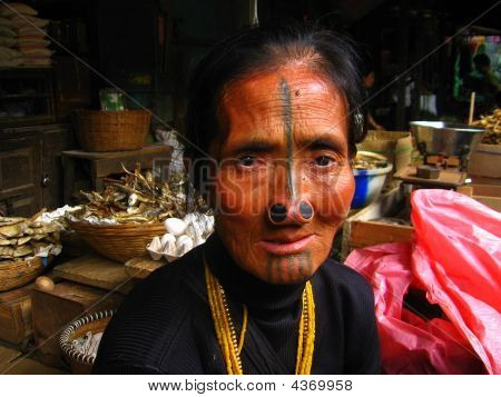 North East Indian Tribal Tattoo on Woman's Face