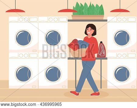 Happy Woman Holding Basket With Washed Clothes At Public Laundry Service. Self-service Laundry With