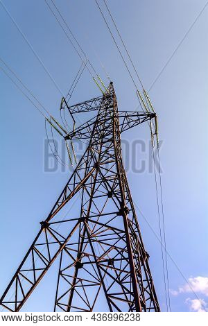 Electrical Supports For High Voltage Cables. A Metal Support With High Voltage Insulators Against Th
