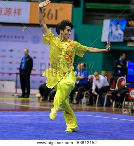 KUALA LUMPUR - NOV 03: Yeap Wai Kin of Malaysia shows his fighting style in the 'changquan compulsory' event at the 12th World Wushu Championship on November 03, 2013 in Kuala Lumpur, Malaysia.