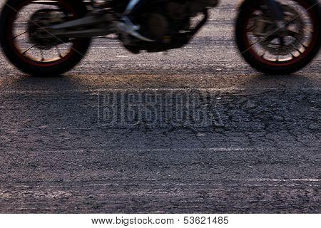 Rapidly traveling along the asphalt road bike poster