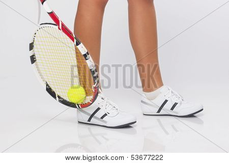 Closeup On The Legs Of Caucasian Female Tennis Player Wearing Professional Outfit Grasping Tennis Ba