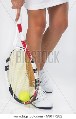 Closeup On Caucasian Female Tennis Sportswoman In Professional Outfit Grasping Tennis Ball With Rack