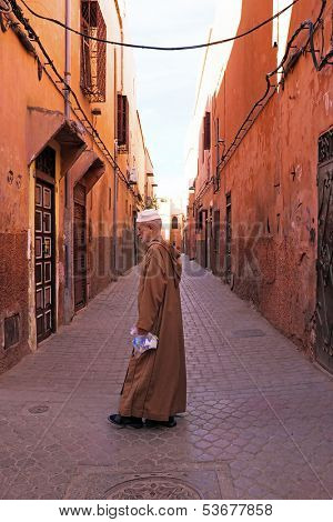 FES, MOROCCO - OCTOBER 22, old man in the medina in Fes on Eid al-Adha. The festival is celebrated by sacrificing a lamb or other animal and distributing the meat to relatives, friends, and the poor.