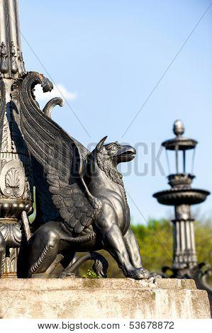 sculpture of griffin on stone pedestal