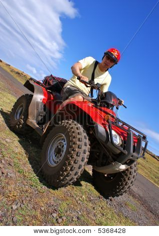 Man On A Red Quad Bike