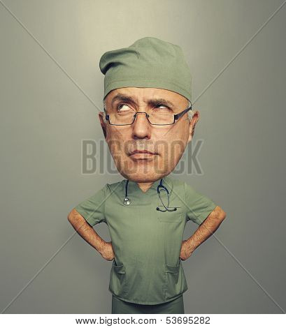 funny picture of bighead pensive doctor in glasses over dark background