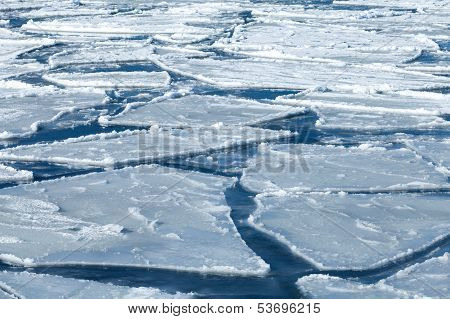 Winter Nature Background With Blocks Of Ice On Frozen Blue Sea