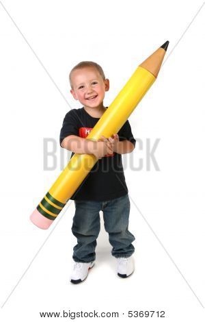 Toddler Schoolage Child Holding Large Pencil