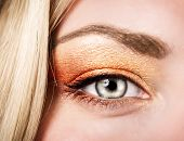 Beautiful autumnal makeup, female face part, stylish golden eyeshadow, fashionable look, beauty concept poster