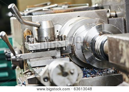 industrial metal work machining process of shaft by cutting tool on lathe