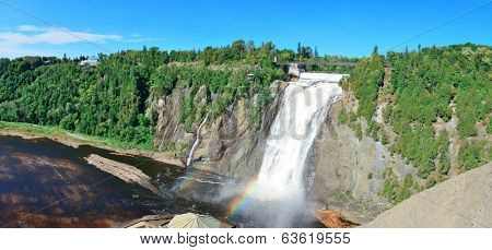 Montmorency Falls panorama with rainbow and blue sky near Quebec City.