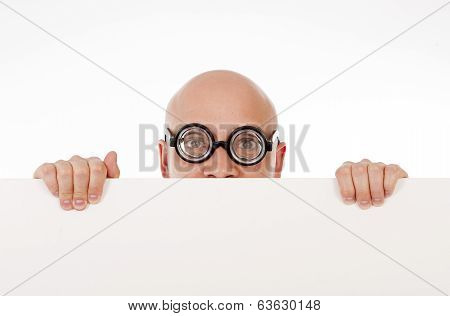 strange looking nerd business man wearing geek glasses holding a white blank sign for copy space or an advertisement on a white background poster