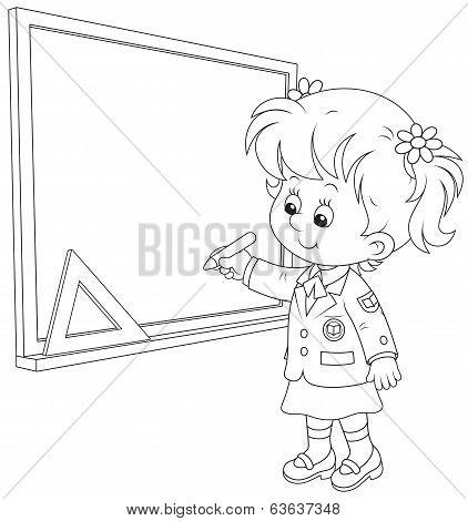 Schoolgirl writes on the blackboard