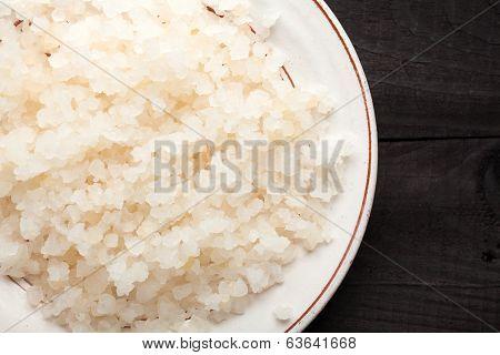 Water kefir grains on black wooden background poster