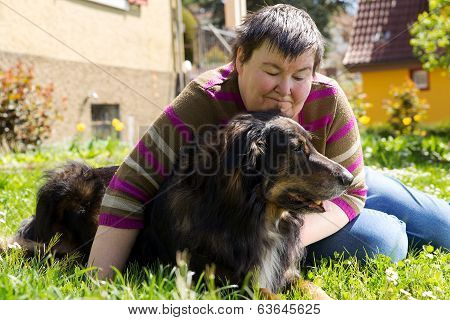 Disabled Woman Is Lying On A Lawn