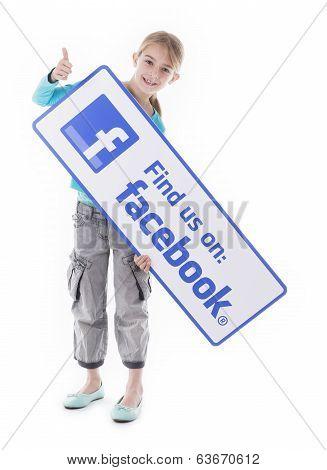 Girl holding find us Facebook sign