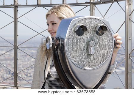 NEW YORK-APR 21, 2014: Actress & Project Sunshine Ambassador Abigail Breslin on the roof of the Empire State Building after flipping the switch to light the building yellow for Project Sunshine Month.