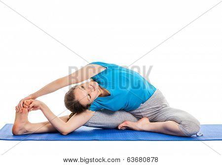 Yoga - young beautiful slender woman yoga instructor doing Revolved Head-to-Knee Pose (parivrtta janu sirsasana) asana exercise isolated on white background