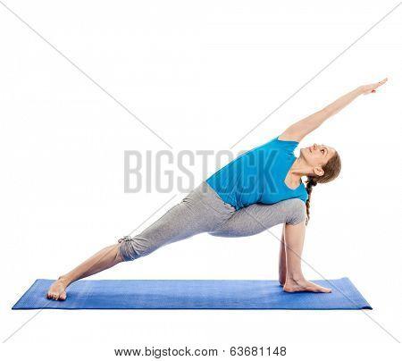 Yoga - young beautiful slender woman yoga instructor doing Extended Sides Angle Pose (Utthita Parsvakonasana) asana exercise isolated on white background