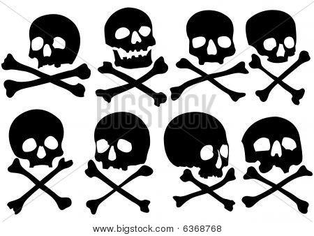 Set of pirate skulls and crossbones