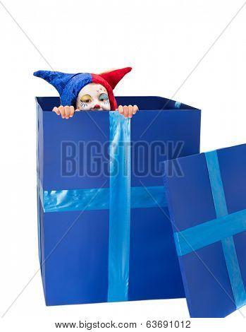 Peek-a-boo girl in a blue box dressed up like a clown