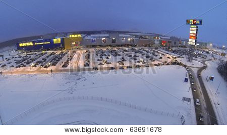 SAMARA, RUSSIA - JAN 05, 2014 : Aerial view to superstore Mega in Samara with large car parking in evening.