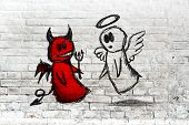 Doodle drawing of angel and devil fighting on white brick wall. Concept of conscience; decisions uncertainty moral dilemma; fight of good and evil. poster