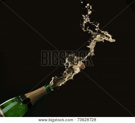 Champagne splashes with cork on black background