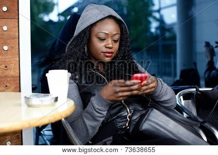 Young Black Woman Busy With Mobile Phone